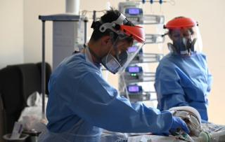 Two surgeons in PPE