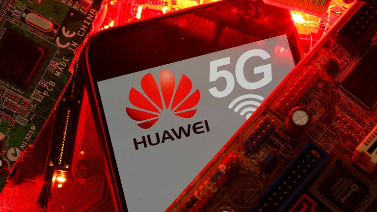 A smartphone with the Huawei and 5G network logo