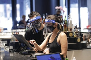 Bartenders wearing masks and face shields at Slater's 50 50 in Santa Clarita, California, yesterday