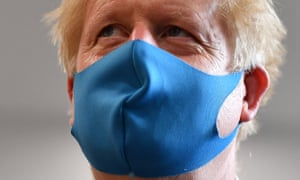 Boris Johnson in mask. (Photo by Ben Stansall-WPA Pool/Getty Images)