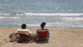 People sunbathe in Arenal beach on June 16, 2020 in Palma de Mallorca (June 2020)