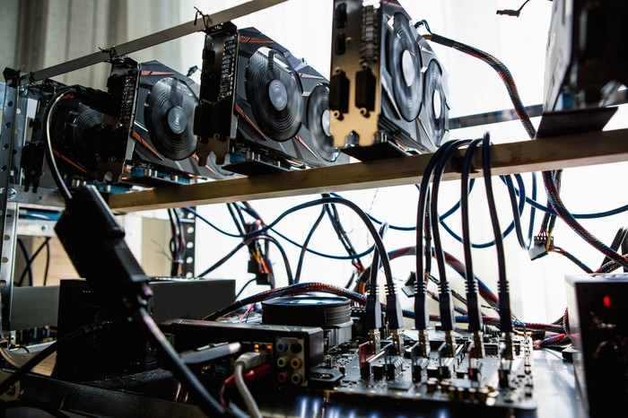 Multiple graphics processing units being used to mine for cryptocurrency.