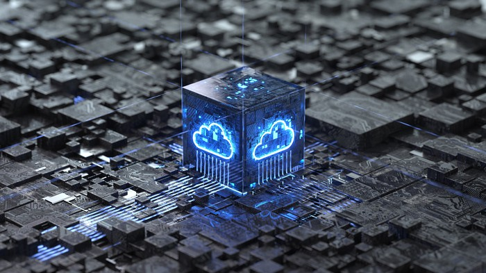 An illuminated blue cloud on a processor box that's surrounded by circuitry.