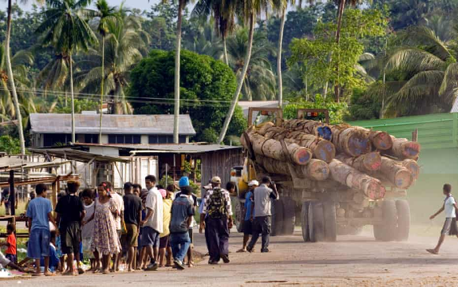 A logging truck heads through the village of Vanimo, Papua New Guinea, en route to the Vanimo Forest Products log camp where the logs will be loaded onto a ship for export to China.
