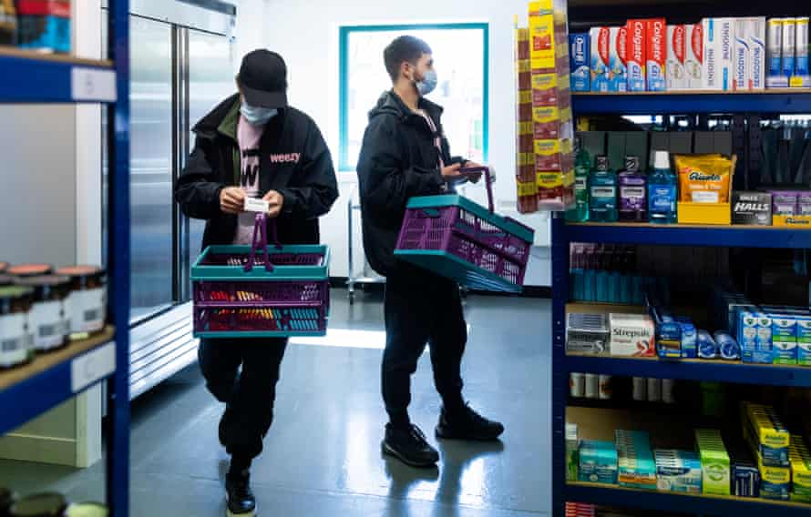 Weezy delivery riders picking orders for delivery at the 'dark store' in Salford.