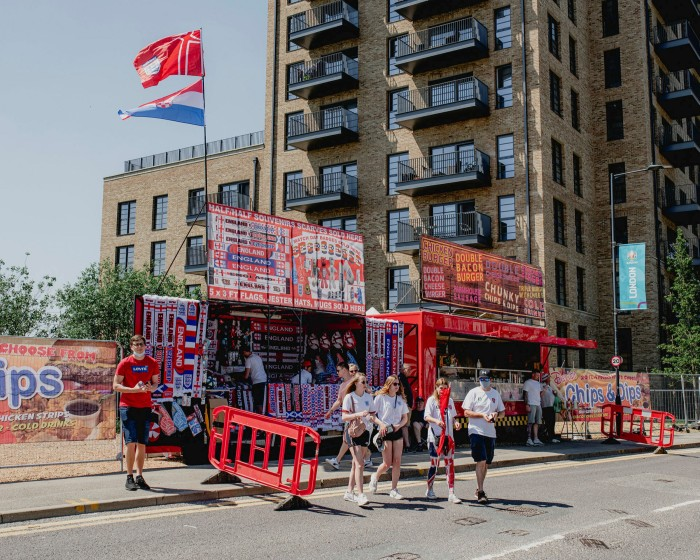 Football fans buy souvenirs at Wembley. Photographed for the FT by Max Miechowski