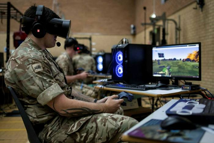 Soldiers from the Duke of Lancaster Regiment take part in trialling virtual reality equipment at their home base in Chester, England.