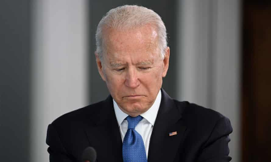 Close up of Joe Biden looking down, as though at his notes or a document