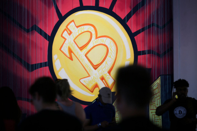 A banner with the logo of bitcoin is seen during the crypto-currency conference Bitcoin 2021 Convention