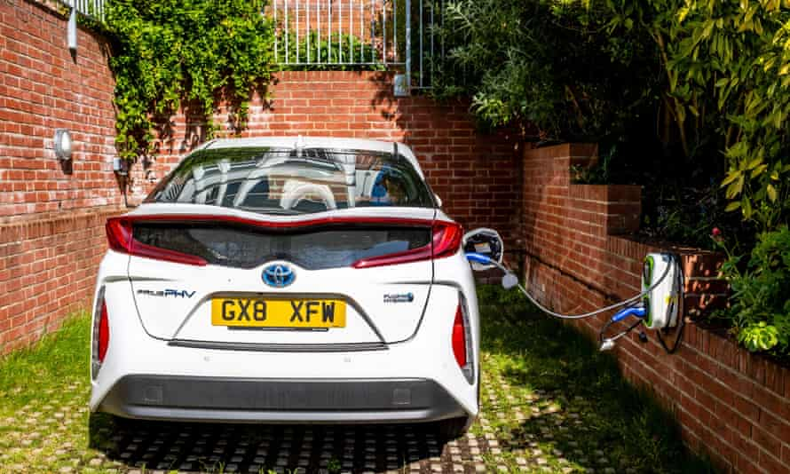A hybrid car being charged