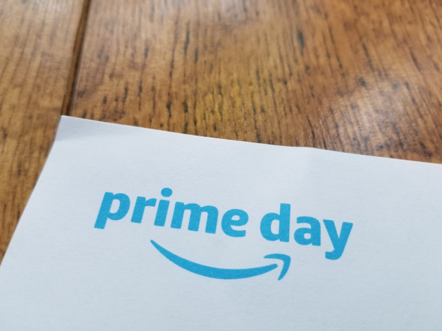 Close-up of logo for Amazon Prime day on a light wooden surface