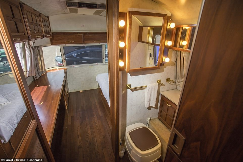 Naturally, the compact bathroom features a 'Hollywood lights' mirror and a decent-size shower unit