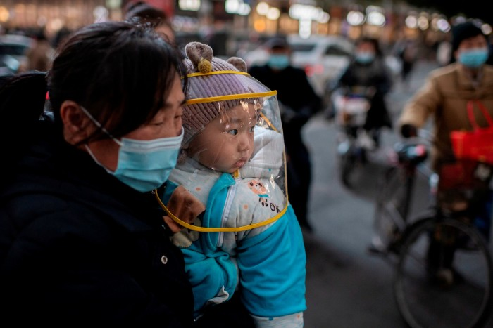 A woman wearing a face mask in Wuhan