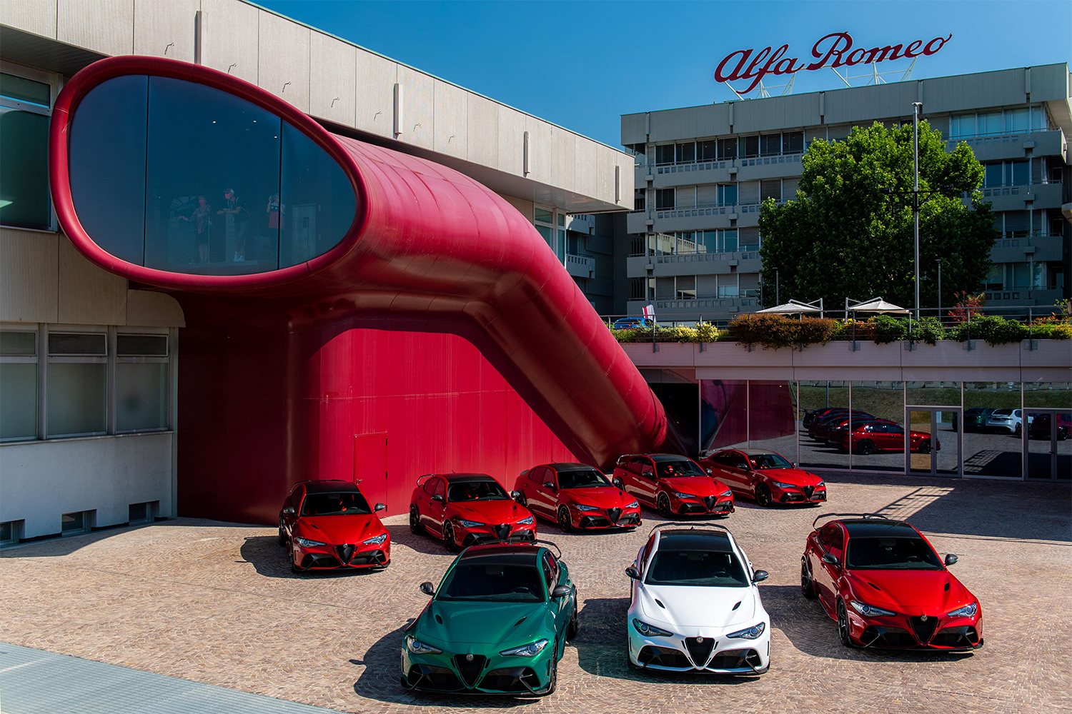 Alfa Romeo's vehicles lined up in red, green and white for the brand's 111th anniversary