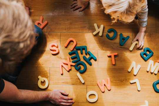 Kids playing with spelling blocks