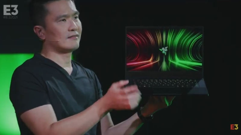 Min-Liang Tan holds the Razer Blade 14 with an AMD processor and Nvidia GeForce 3080 RTX graphics.