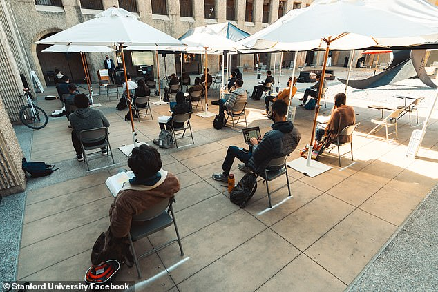 At least seven fully-vaccinated students at Stanford University have tested positive for coronavirus, school officials announced Thursday. Pictured: Students socially distance during a class held outside at the Ivy League in California
