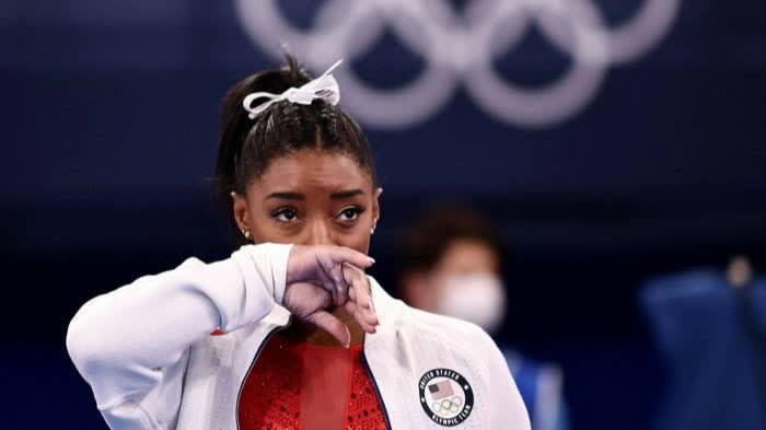 'I just don't trust myself as much as I used to,' a tearful Simone Biles said. 'I don't know if it's age, I'm a little bit more nervous when I do gymnastics' © Loic Venance/AFP/Getty