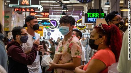 Visitors to the Grand Central Market are mostly masked on Tuesday, in Los Angeles, California.