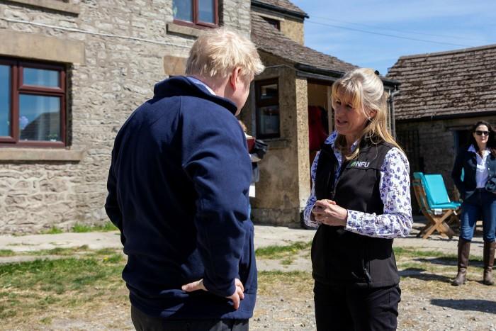 Prime Minister Boris Johnson visits a farm with NFU president Minette Batters