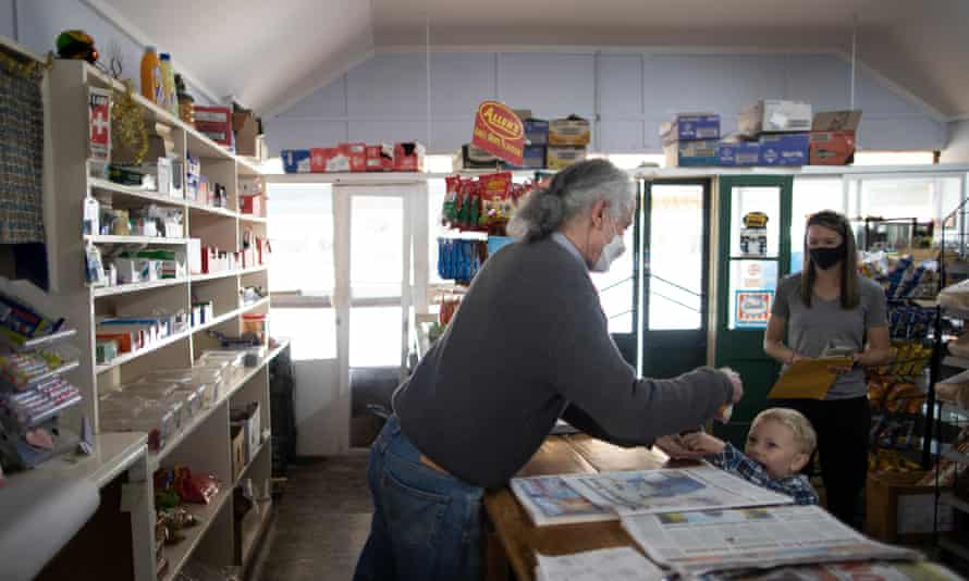 Binalong store owner Bill Kosseris prepares a $1 bag of lollies for Ian