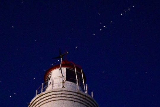 VLADIVOSTOK, RUSSIA - APRIL 27, 2020: 60 of the Starlink Internet communication satellites of Elon Musk's SpaceX private spaceflight company seen in the night sky. On April 22, 2020, SpaceX successfully launched 60 Starlink satellites into orbit on the Falcon 9 rocket from NASA's Kennedy Space Center at Cape Canaveral. The Starlink project is aimed at providing low-cost internet to remote locations; SpaceX is planning to launch into orbit about 30,000 satellites. Following the launch of the first batch of the Starlink satellites, the International Astronomical Union (IAU) and the US National Radio Astronomy Observatory (NRAO) expressed concerns about the satellites being too bright and forming a 'megaconstellation' and thus causing serious problems for astronomers. Yuri Smityuk/TASS (Photo by Yuri Smityuk\TASS via Getty Images)