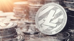 Image of one litecoin in front of many stacks of litecoins