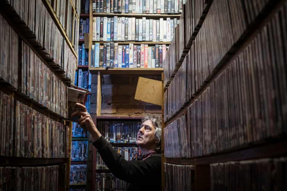 Derek returns DVDs into their place among the library