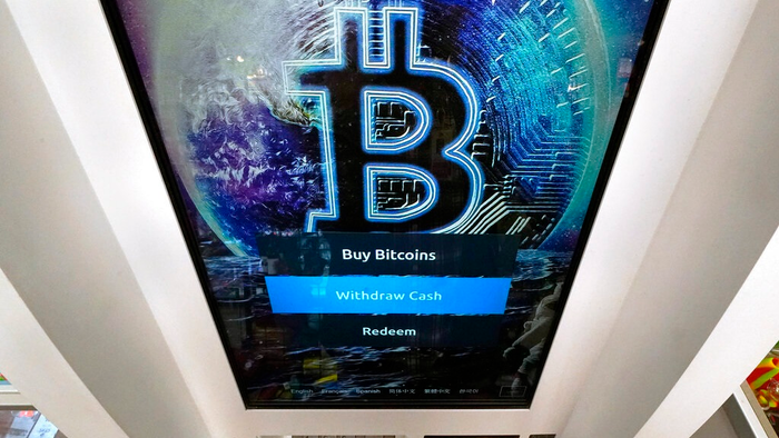 In this Feb. 9, 2021, file photo, the Bitcoin logo appears on the display screen of a cryptocurrency ATM at the Smoker's Choice store in Salem, N.H. China's central bank on Friday, Sept. 24, 2021, declared all transactions involving Bitcoin and other virtual currencies illegal, stepping up a campaign to block use of unofficial digital money.