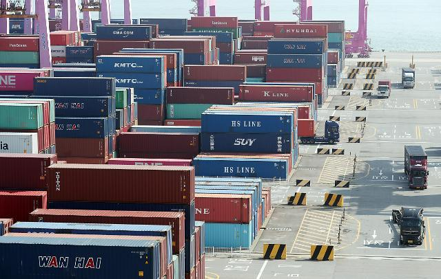 This file photo, taken Sept. 9, 2021, shows stacks of containers at a port in Incheon, 40 kilometers west of Seoul. (Yonhap)
