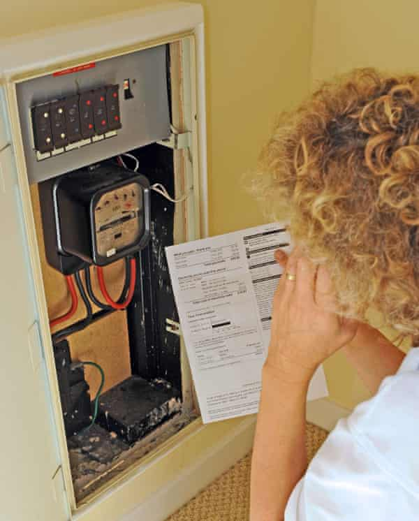 Woman reads her electricity meter