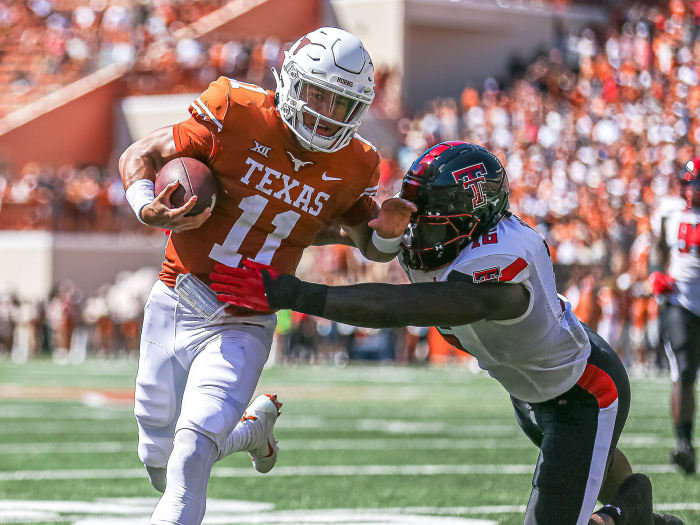 Texas QB Casey Thompson tries to elude a defender's tackle