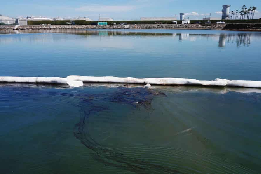 Booms placed by crews to contain oil that flowed near the Talbert Marsh and Santa Ana River mouth, during cleanup efforts after the recent spill.
