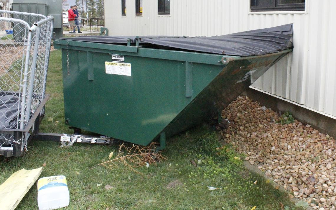 A dumpster remains embedded in the side of a building Sunday, Oct. 10, 2021 at Faithbridge Church after winds dragged it down the parking lot in Saturday's severe storm. Robin Fish / Park Rapids Enterprise