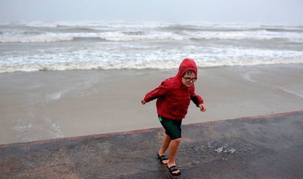 Cyclones: A child plays on the seafront in the aftermath of a hurricane