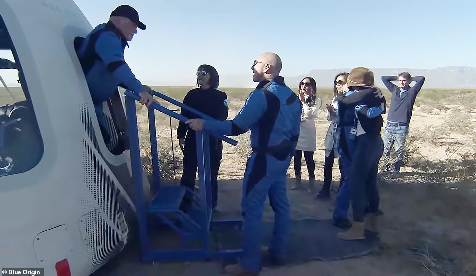 Star Trek's William Shatner has become the oldest person in space at the age of 90 - and he's come back with one message: 'Everybody in the world needs to see this'. Shatner and newly minted astronauts Chris Boshuizen, Glen de Vries and Audrey Powers stepped out of the New Shepard's iconic white capsule in West Texas following their first mission to the final frontier, where they spent three minutes in zero-gravity after reaching an altitude of roughly 350,000ft and a velocity of about 2,000mph. Pictured: Jeff Bezos greets the newly minted astronauts as they exit the capsule after their trip