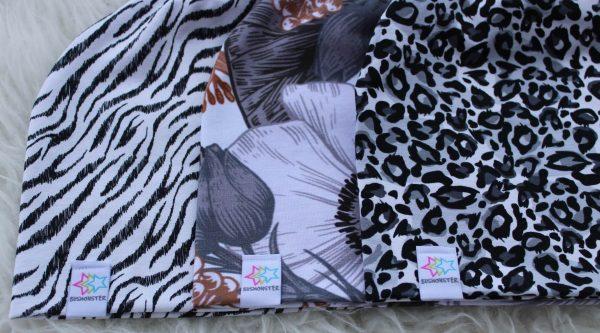 Mössa grafiska mönster vuxen barn leopard zebra blommor