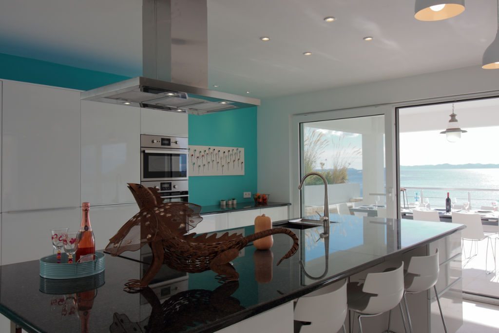 Fully equipped kitchen sea view outside dining table for 12