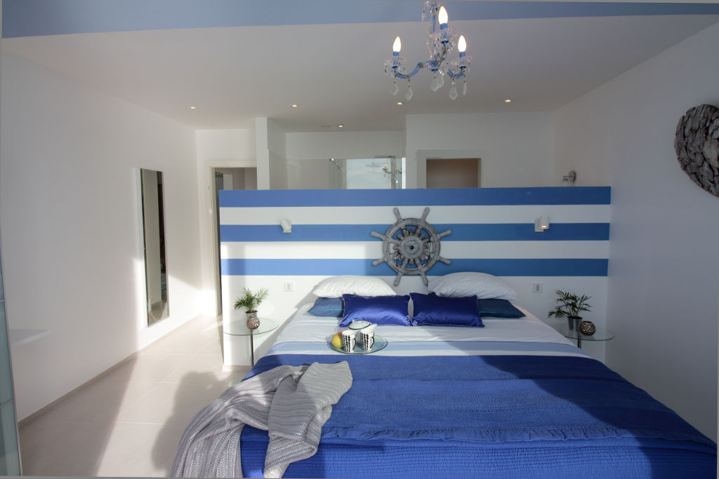 Marine bedroom kingsize double bed bathroom and WC behind striped wall