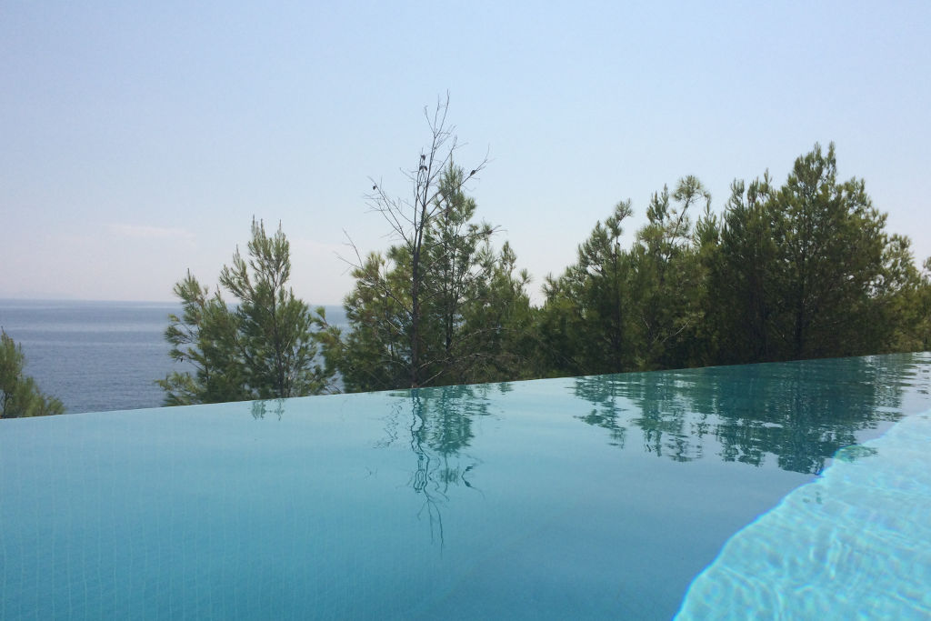 Luxury villa infinity pool sea view pine trees
