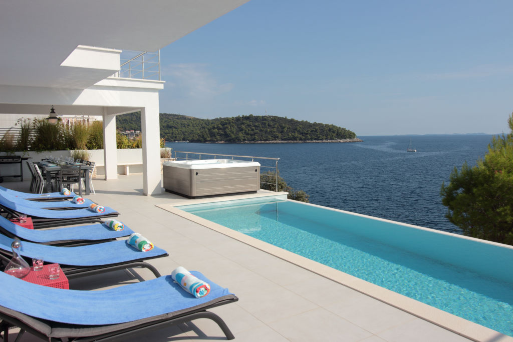 Outside pool terrace, sunloungers, infinity pool, jacuzzi, sea view