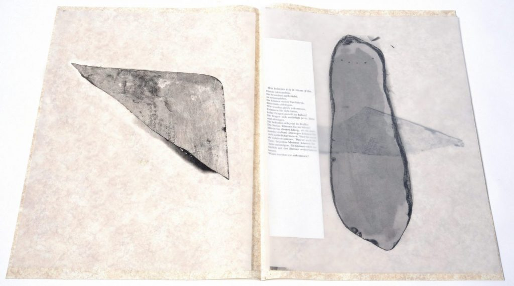 "3 fragments of a lithographic stone with a ""ghost print"" of an ancient german posterr,"