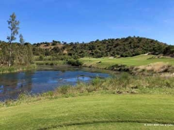 Golfers on Monte Rei Golf and Country Club Course Portugal