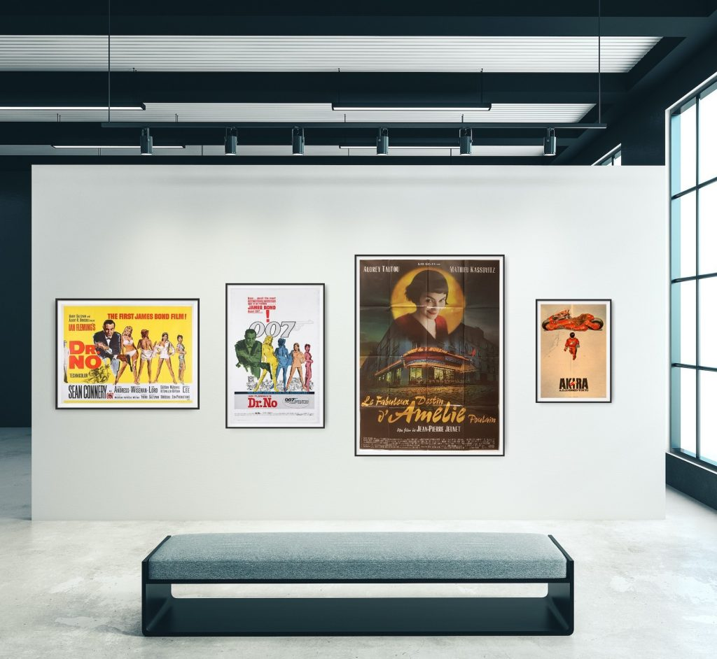 The image, from left to right, shows a Dr. No UK Quad Cinema Poster, a Dr. No US One Sheet poster, a French Grande for the film Amelie and a Japanese B2 poster for the film Akira. Images of all posters are shown to scale hanging on a gallery wall.