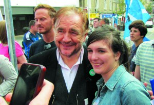 Brian Cox posing for photographs