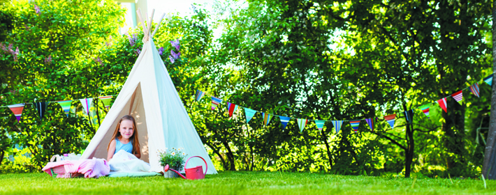 Little Girl Camping in the Garden
