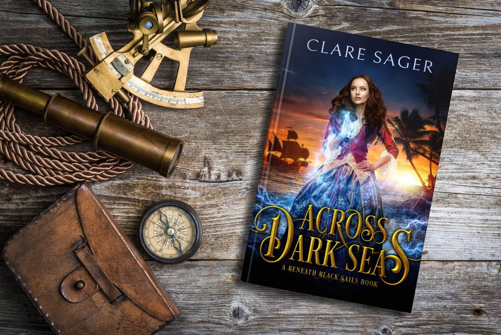 Across Dark Seas cover on table with nautical equipment