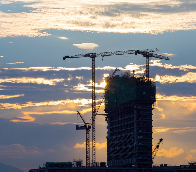 unfinished-concrete-building-with-tower-crane-1402923.jpg