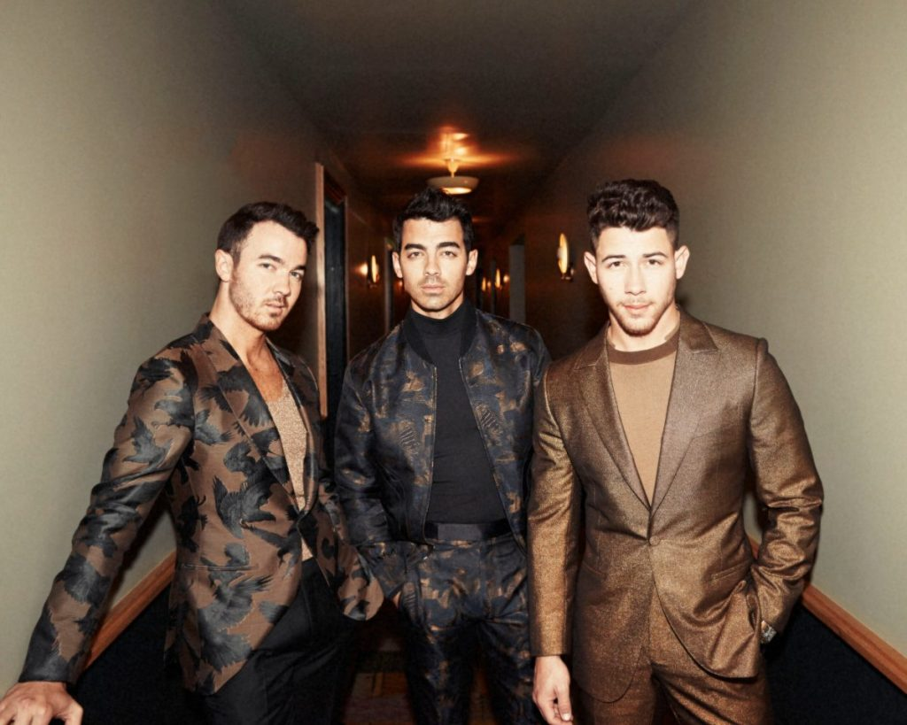 The Jonas Brothers Release Two New Tracks Latin Anthem 'X' and Slick Pop Ballad '5 More Minutes'