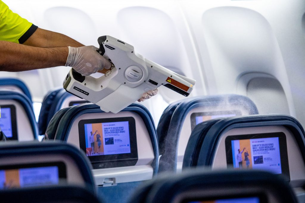 Delta airlines expand their cleaning processes to include a fogging procedure that disinfects surface areas that are often touched in the aircraft.